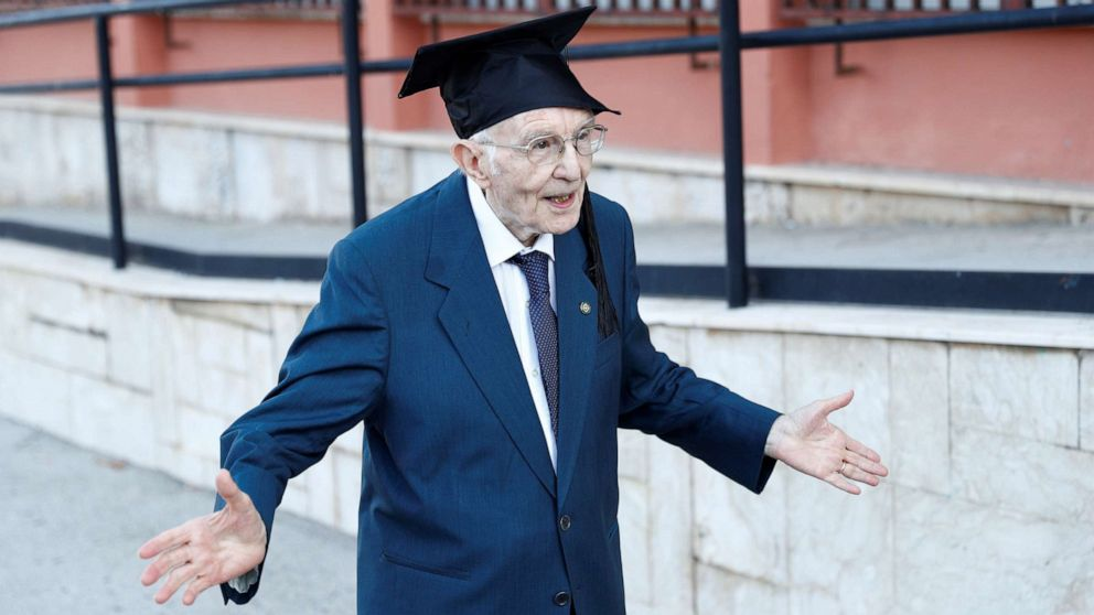 PHOTO: Giuseppe Paterno, 96, Italy's oldest student, celebrates after graduating from his undergraduate degree in history and philosophy during his graduation at the University of Palermo, in Palermo, Italy, July 29, 2020.