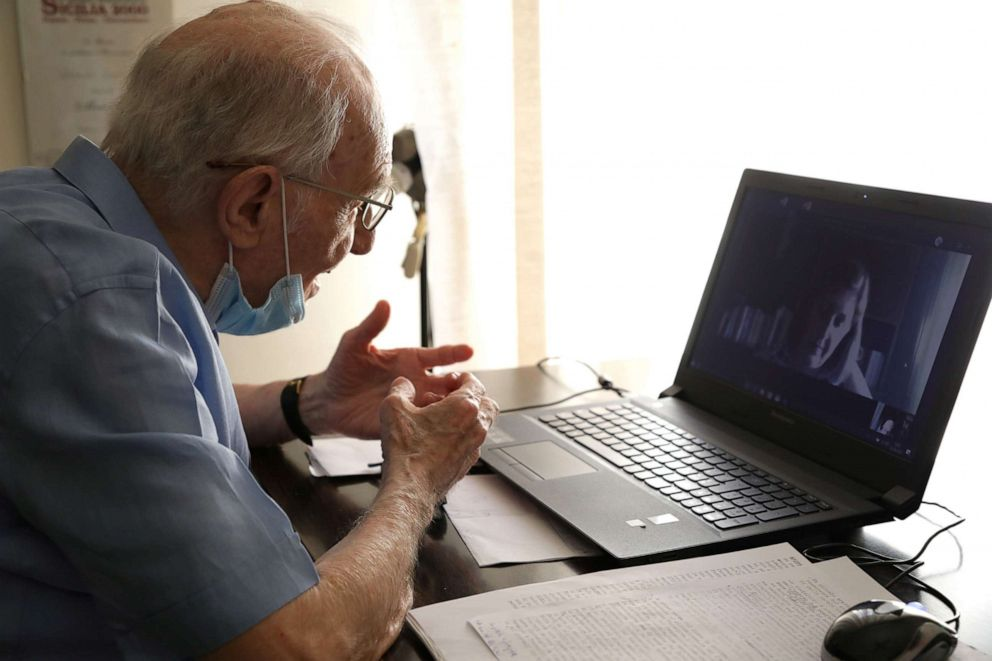 PHOTO: Giuseppe Paterno, 96, Italy's oldest student, takes his final exam online, for his undergraduate degree that he has been studying at the University of Palermo, using a laptop at his home, in Palermo, Italy, June 23, 2020.