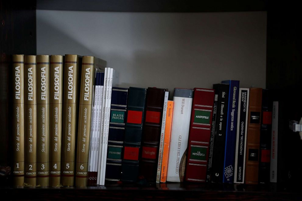 PHOTO: Philosophy books belonging to Giuseppe Paterno, 96, Italy's oldest student, stand on a shelf, a day before he graduates from The University of Palermo with an undergraduate degree in history and philosophy in Palermo, Italy, July 28, 2020.