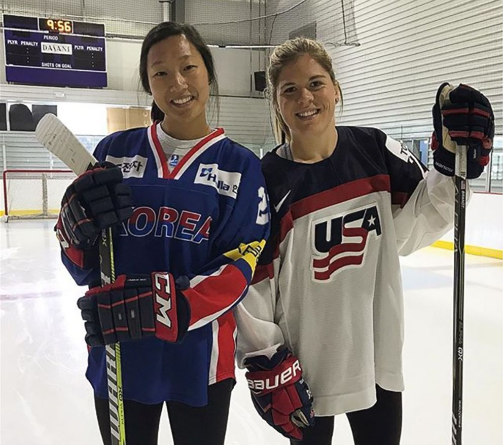 Ice hockey players Marissa Brandt who will play for South Korea in the coming Winter Olympic Games in Pyeongchang, and her sister Hannah Brandt who will play for the USA team, pose at Florida Hospital Center Ice in Wesley Chapel, Fla. in October 2017.