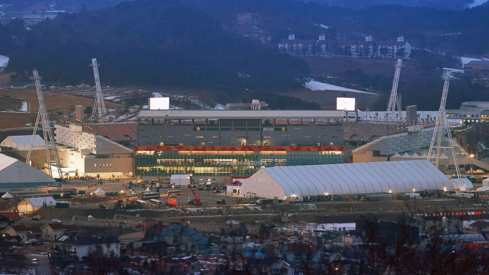 Final preparations are under way at the Pyeongchang Olympic Stadium in South Korea on Feb. 8, 2018, a day before the opening ceremony of the Winter Olympics.