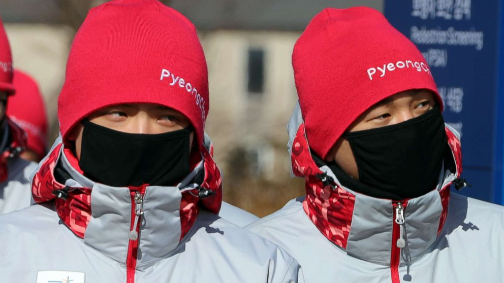 PHOTO: Volunteers protect their faces from the cold at the Olympic stadium of the Pyeongchang Winter Olympic Games in Pyeongchang, South Korea Feb. 7, 2018.