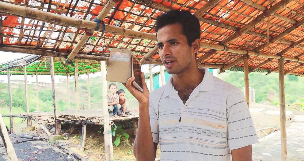 PHOTO: Omar Faruk, who lives in Bangladeshs Chakmarkul camp, called his grandfather in Myanmar to check on his safety, in Nov. 2018.