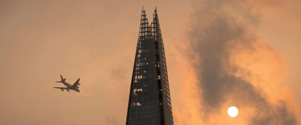 PHOTO: A plane flies past the Shard in central London, as the sky takes on an unusual orange color caused by Hurricane Ophelia, Oct. 16, 2017.