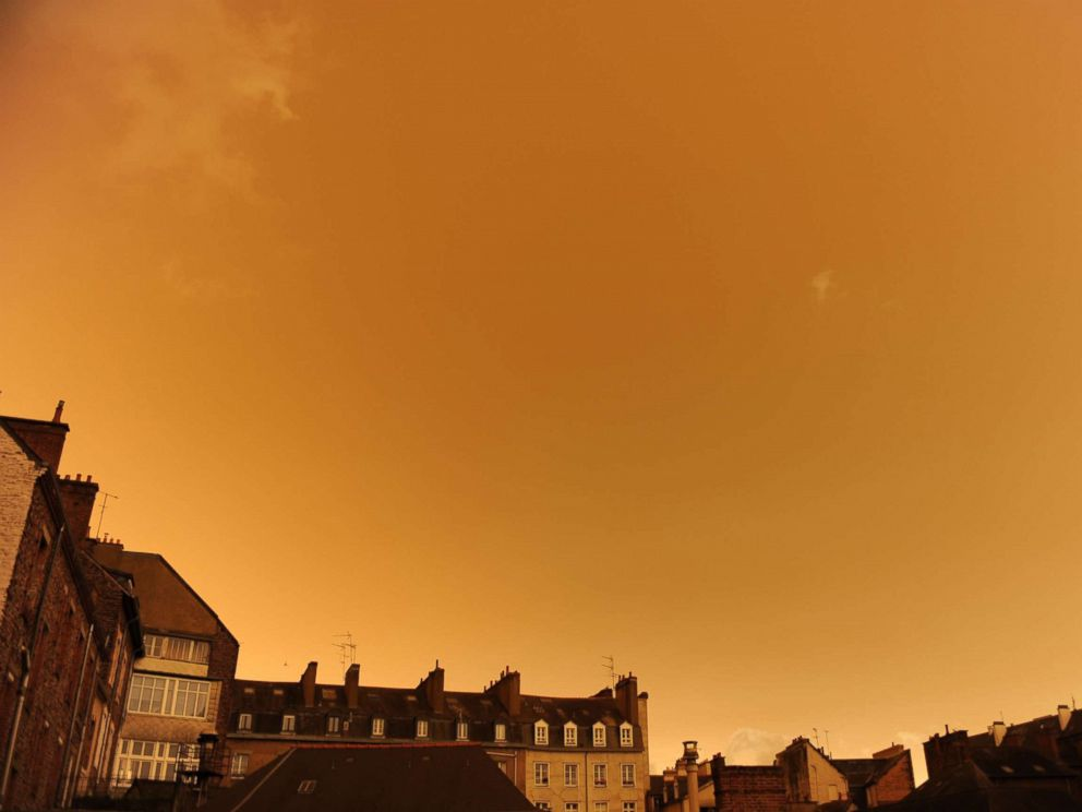 PHOTO: A surreal sky over central Rennes, western France, Oct. 16. 2017, after it turned a yellow-ochre color due to sand from the Sahara desert and dust from wildfires in Portugal being carried by wind.