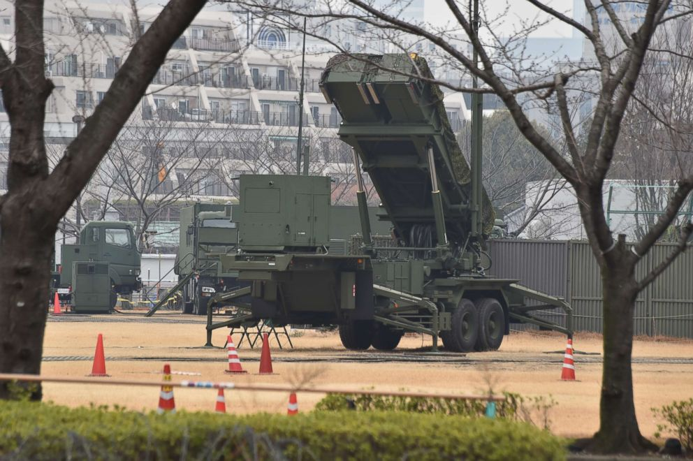 PHOTO: A PAC-3 surface-to-air missile launcher unit (C), used to engage incoming ballistic missile threats, is seen in position at the Defence Ministry in Tokyo on March 6, 2017.