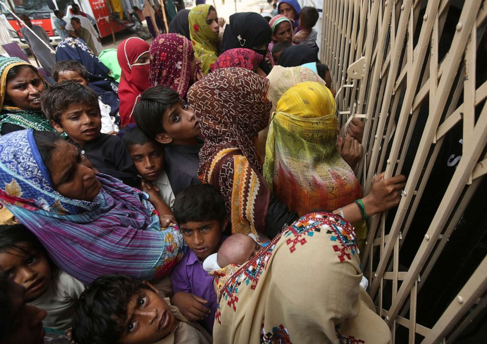 PHOTO: Villagers wait outside a hospital for blood screening in the southern province of Sindh, Pakistan, May 16, 2019, where about 500 people, mostly children, have tested positive for HIV.
