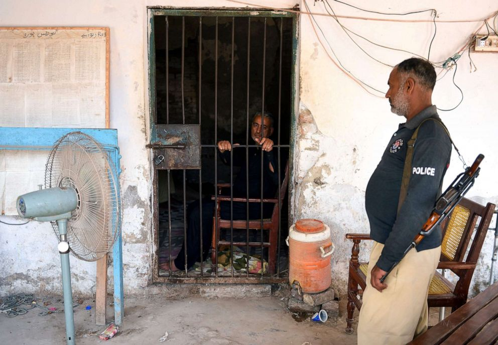 PHOTO: Pediatrician, Dr. Muzaffar Ghanghro, who authorities suspect knowingly spread HIV, sits behind bars on May 9, 2019, at a local police station in Sindh province, Pakistan.
