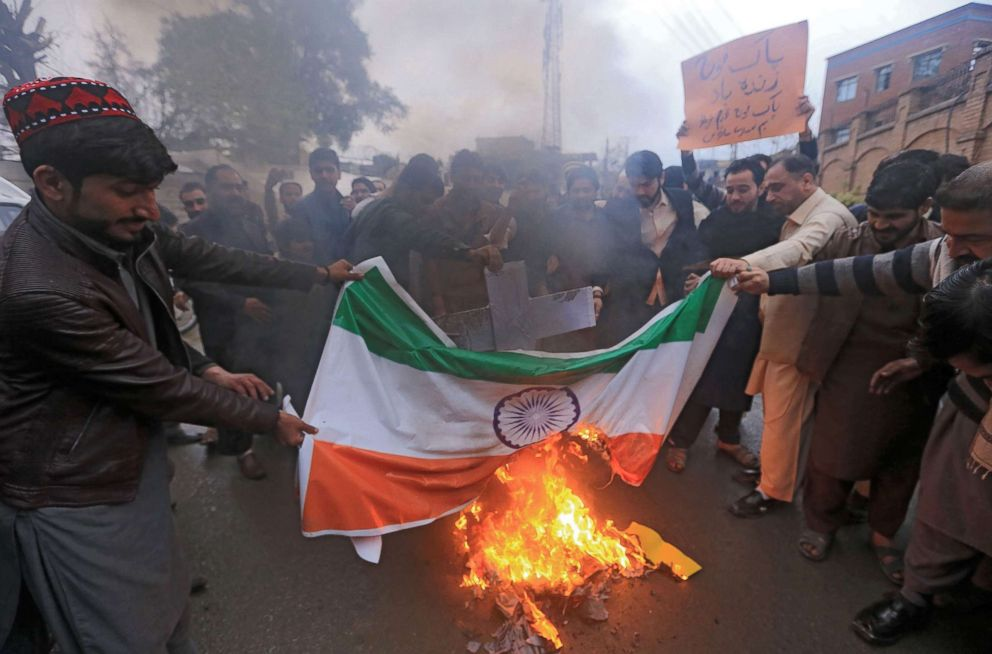 PHOTO: Pakistani protesters burn an Indian national flag in Peshawar on Feb. 26, 2019, following the Indian Air Force strike.