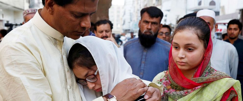 PHOTO: Aziz Sheikh father of Sabika Aziz Sheikh, a Pakistani exchange student, who was killed with others when a gunman attacked Santa Fe High School in Santa Fe, Texas, comforts her friends, during a funeral in Karachi, Pakistan May 23, 2018.