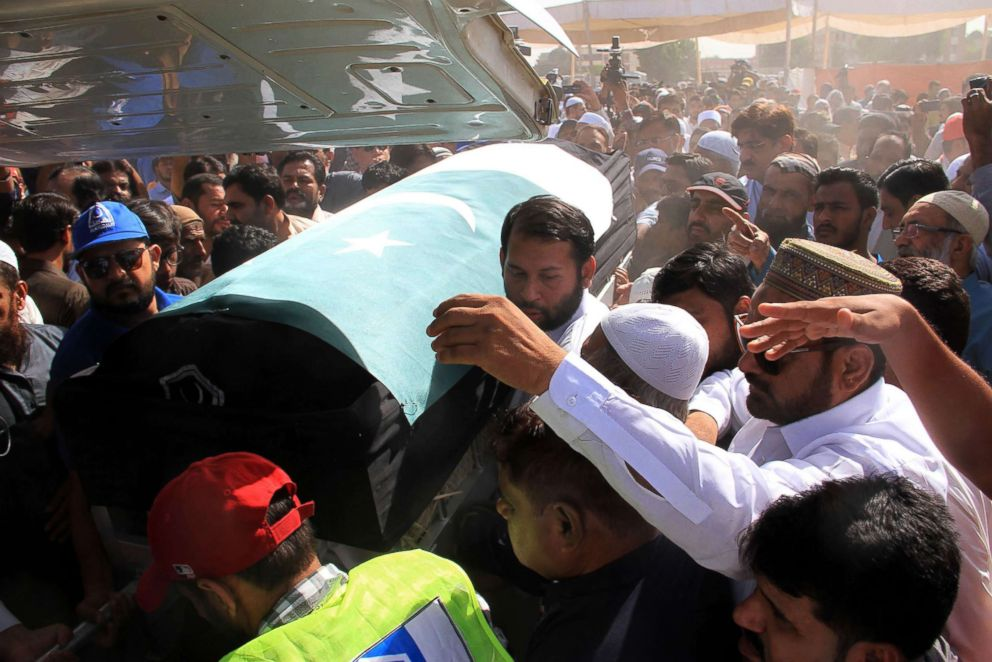 PHOTO:Relatives and residents carry the coffin of Sabika Sheikh in Karachi, May 23, 2018.