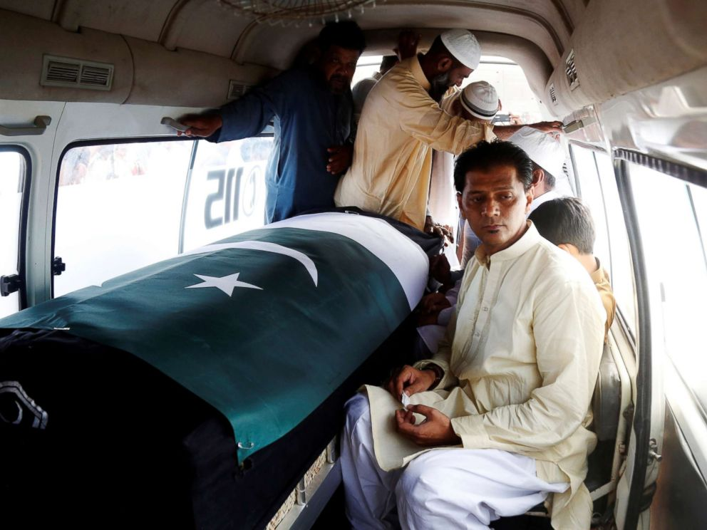 PHOTO: Aziz Sheikh father of Sabika Aziz Sheikh, who was killed when a gunman attacked Santa Fe High School in Santa Fe, Texas, sits in an ambulance next to her coffin, wrapped in national flag, during a funeral in Karachi, Pakistan May 23, 2018.