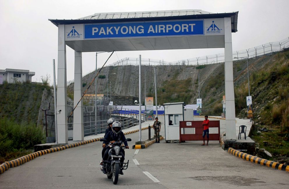 PHOTO: People ride a motorbike as they leave Pakyong Airport, the northeastern Sikkim States first airport, after its inauguration by Prime Minister Narendra Modi in Pakyong, India Sept. 24, 2018.