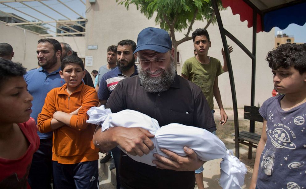PHOTO:A man cries as he carries the body of a four-month-old Palestinian girl Maria Al-Ghazali, who was killed along with her parents Sunday night by an Israeli missile strike, during her funeral in town of Beit Lahiya, northern Gaza Strip, May. 6, 2019.
