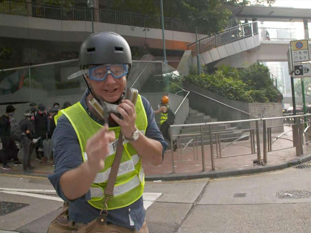 PHOTO: ABCs Ian Pannell reports during the protests in Hong Kong, Oct. 1, 2019, wearing a high-visibility vest with Press on it.