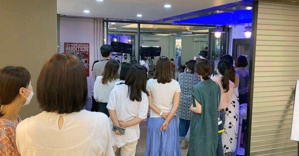 PHOTO: Parents watch their children learn K-pop dance at Shine Dance Academy in Seoul, June 25, 2021.