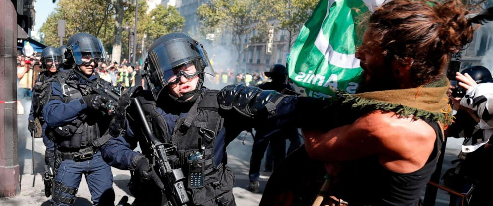 PHOTO: A demonstrator clashes with riot policemen during the Climate Change protest, on Sept. 21, 2019 in Paris.