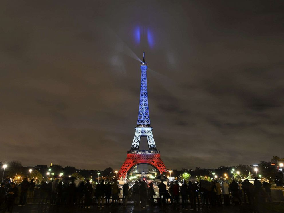 PHOTO: The Eiffel Tower is illuminated in the colors of the French flag to honor victims of Paris attacks, Nov. 17, 2015, in Paris.