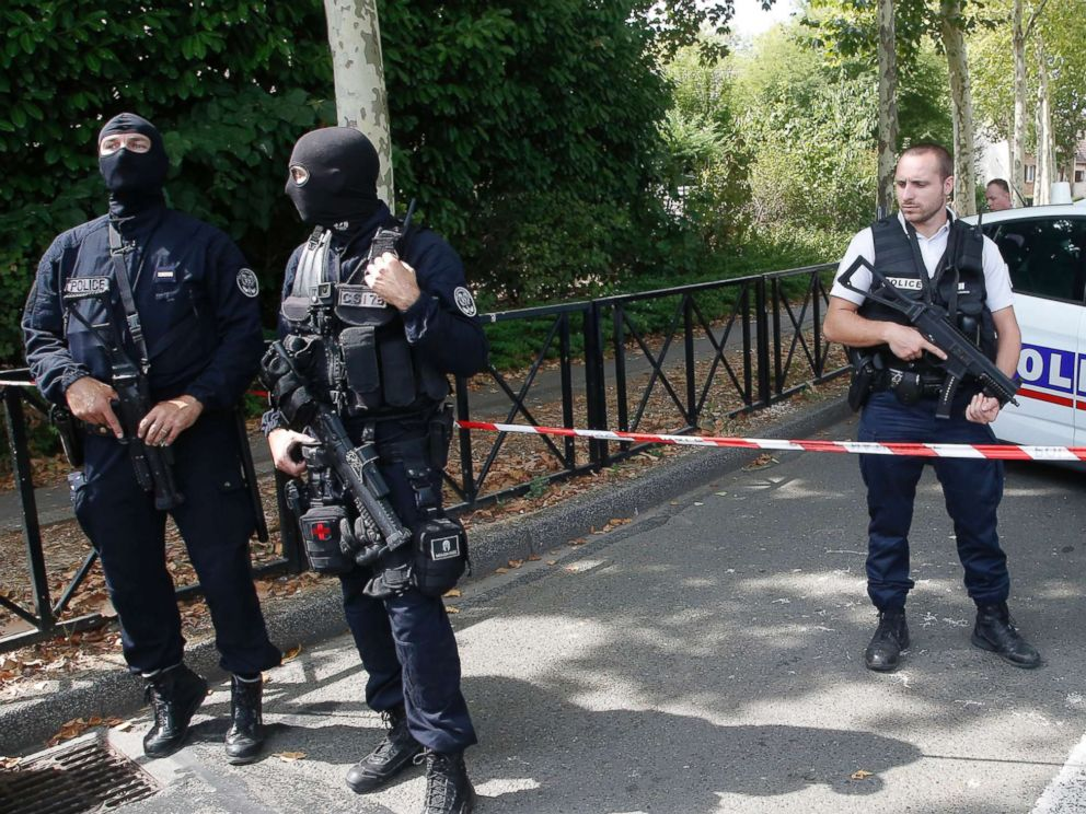 PHOTO: French police officers guard the area with other police officers after a knife attack Aug. 23, 2018 in Trappes, west of Paris.