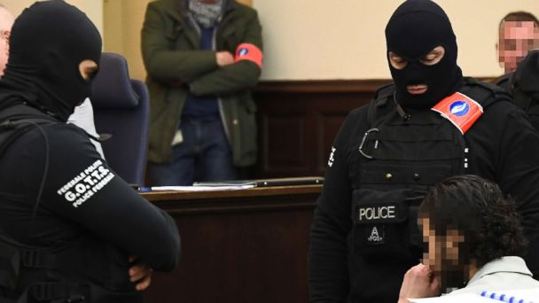 Paris attacks suspect refuses to stand, answer questions at trial