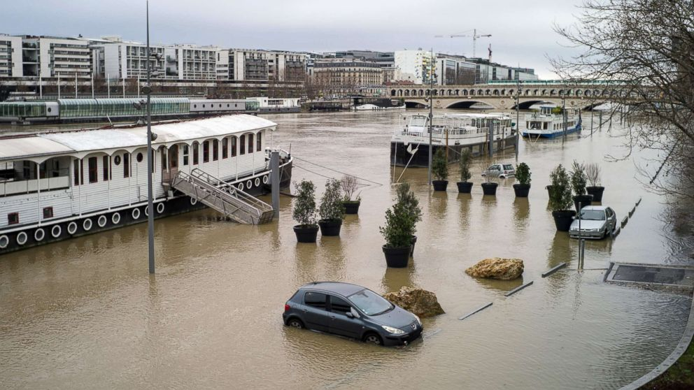 Submerged cars are seen along the flooded banks of the Seine river in Paris, Jan. 23, 2018.