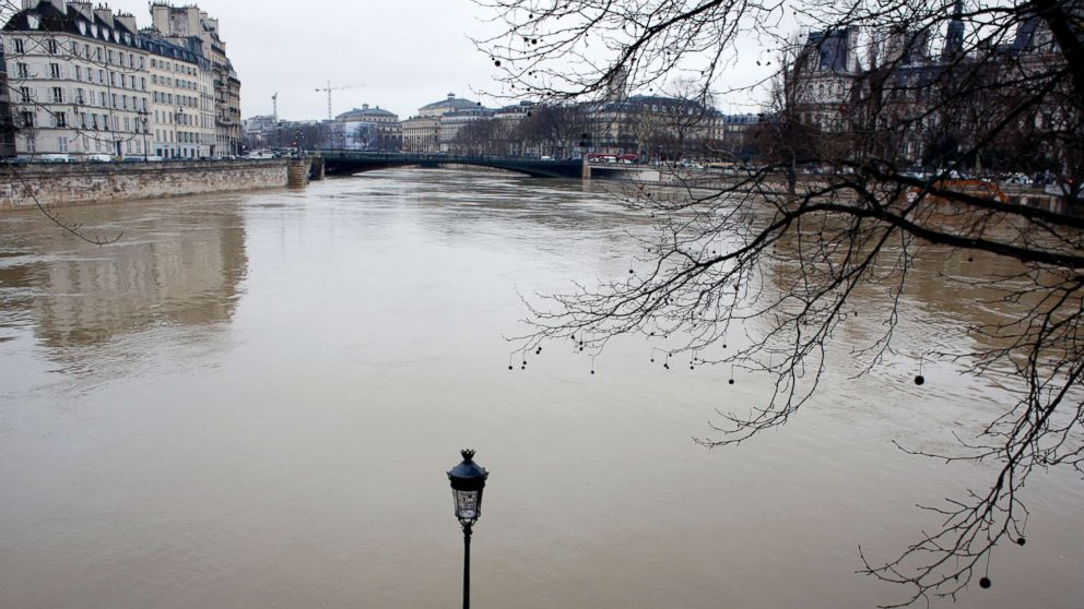 A flooded street lamp is pictured in Paris, Jan.23, 2018.