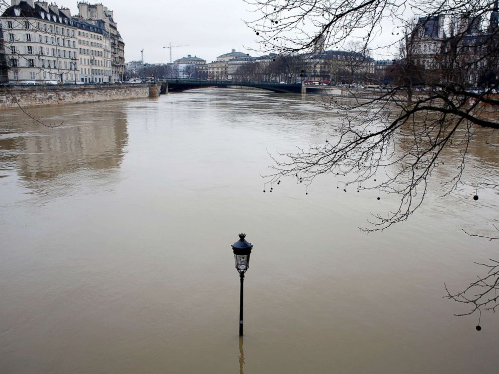 PHOTO: A flooded street lamp is pictured in Paris, Jan.23, 2018.
