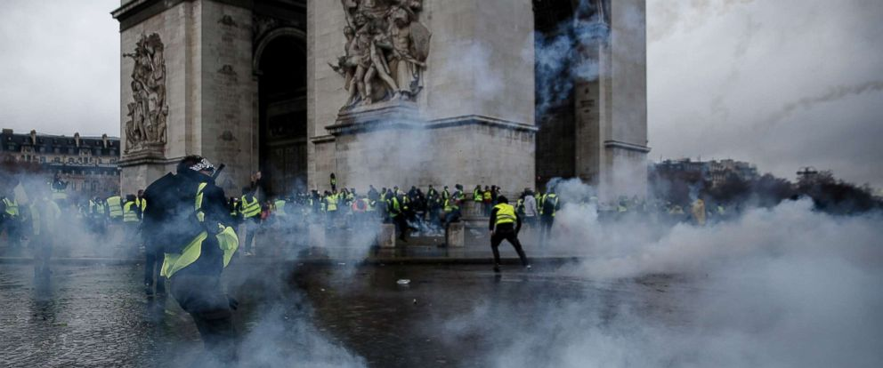 PHOTO: Demonstrators clash with riot police at the Arc de Triomphe during a protest of Yellow vests against rising oil prices and living costs, Dec. 1, 2018, in Paris.
