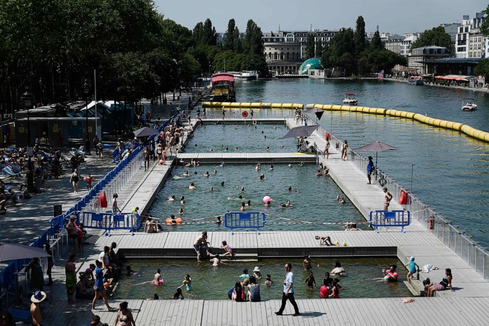 PHOTO: People cool off at floating pools set up on the Ourcq canal in Paris on July 25, 2019, as a new heatwave hits Europe.
