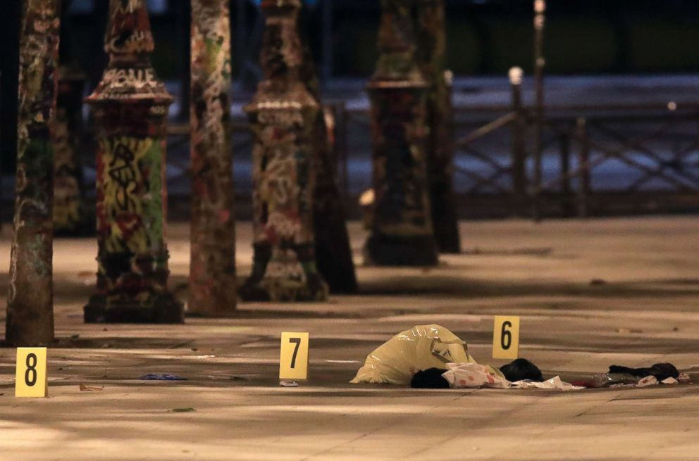 PHOTO: Evidence markers sit on the pavement after seven people were wounded in a knife attack downtown Paris, Sept. 10, 2018.