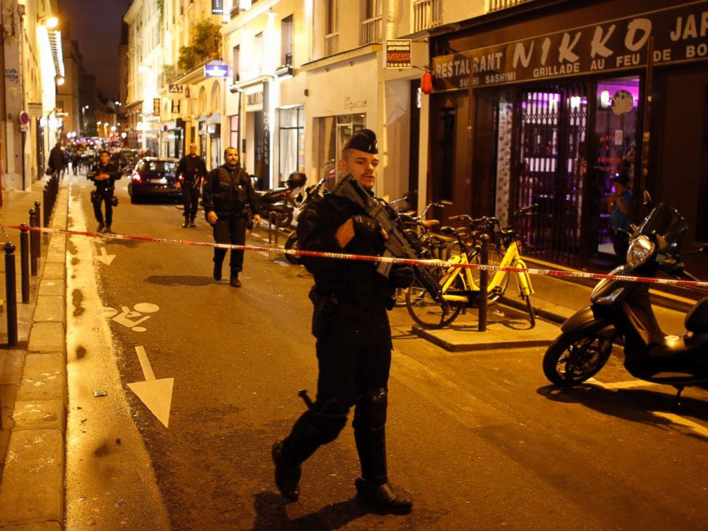 PHOTO: A police officer cordons off the area after a knife attack in central Paris, May 12, 2018.
