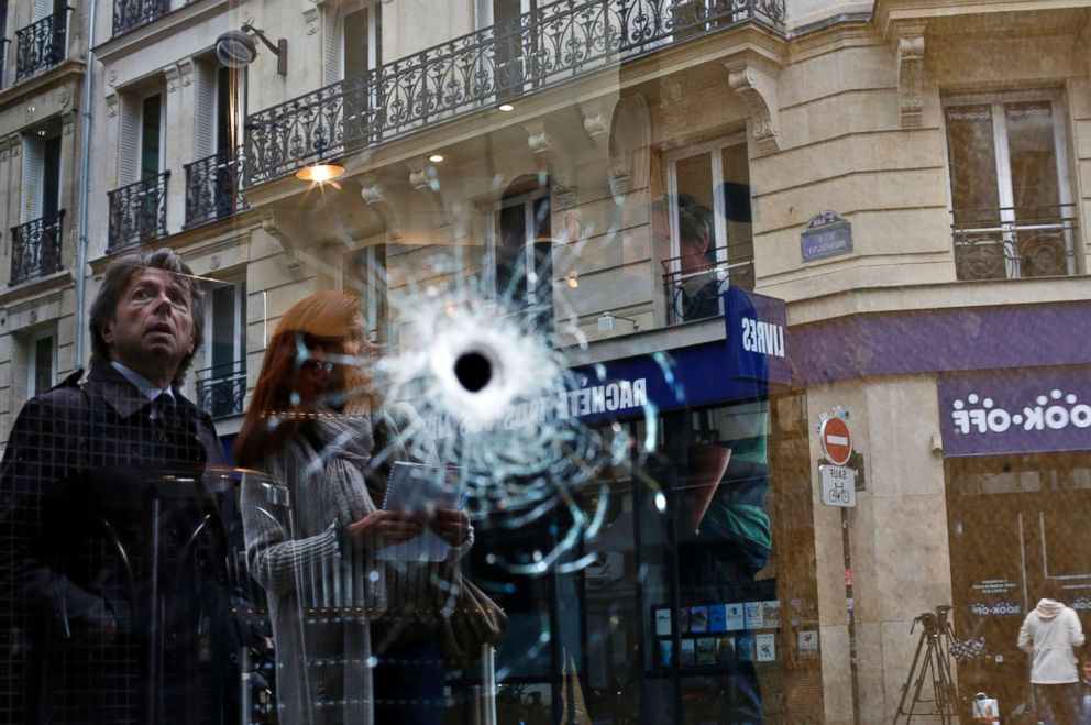 PHOTO: A bullet hole seen on the window of a cafe located near the area where the assailant of a knife attack was shot dead by police officers, in central Paris, May 13, 2018.