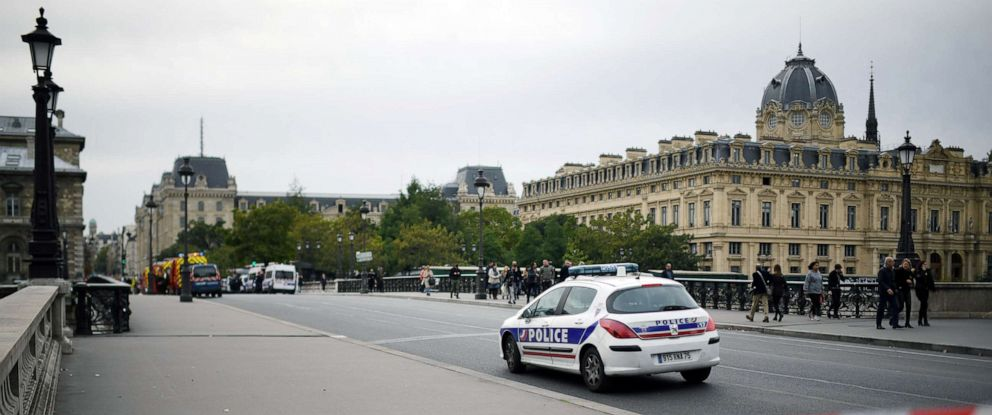 PHOTO: A police car drives past a safety cordon near Paris police headquarters on Oct. 3, 2019.