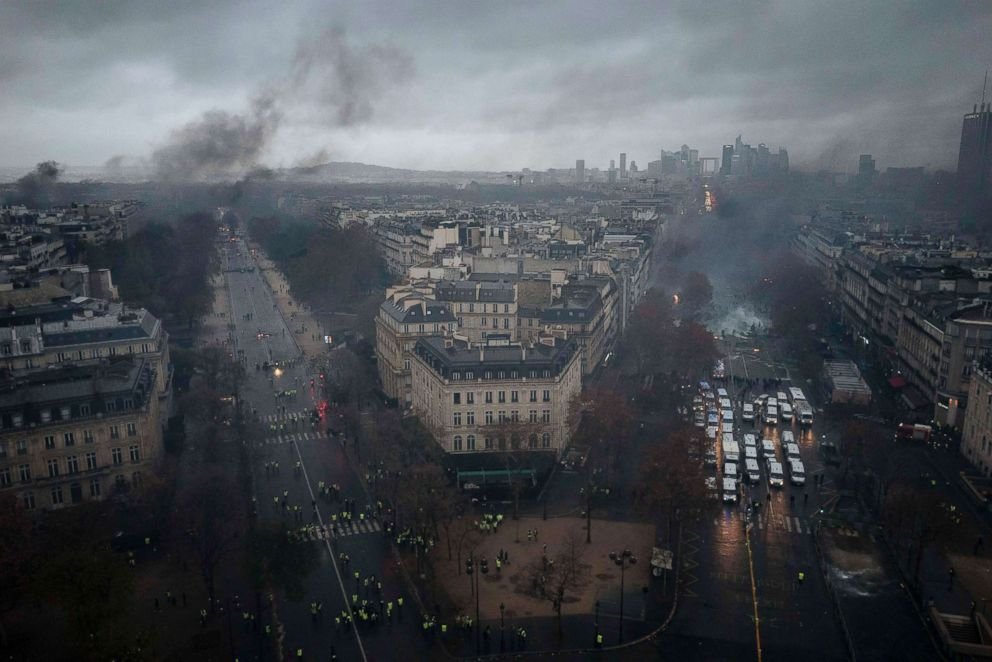 PHOTO: Avenues leading to the Arc de Triomphe are viewed from the top of the Arc de Triomphe on the Champs-Elysees during a demonstration, Dec.1, 2018 in Paris. A protest turned into a riot as police fired tear gas in street battles with activists.