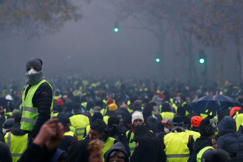 PHOTO: Protesters wearing yellow vests, a symbol of a French drivers protest against higher diesel taxes, demonstrate near the Place de lEtoile in Paris, Dec. 1, 2018.
