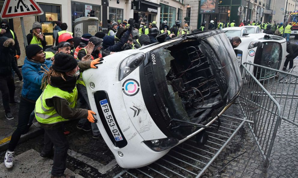 PHOTO: Demonstrators destroy cars during a protest of Yellow vests against rising oil prices and living costs, near the Champs Elysees in Paris, Dec. 1, 2018.