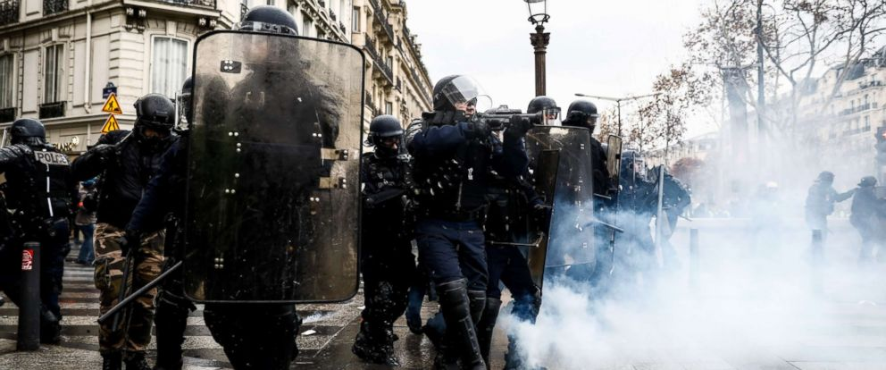 "PHOTO: Riot police prepares to shoot tear gas on the Champs Elysees avenue in Paris, Dec. 8, 2018, during a protest of ""yellow vests."""