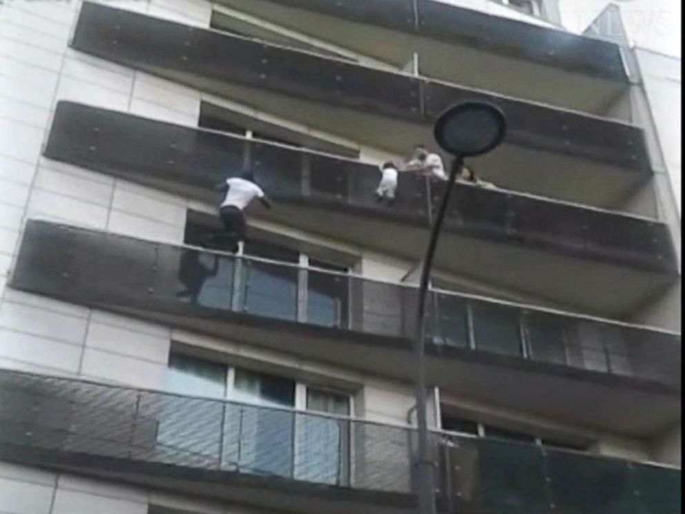 PHOTO: A video by Tadek Dandach shows Mamoudou Gassama, 22, from Mali, scaling the outside of an apartment building to rescue a four-year-old boy in Paris.  Father of boy dangling from Paris balcony was out playing Pokémon Go, prosecutor says Father of boy dangling from Paris balcony was out playing Pokémon Go, prosecutor says paris rescue 02 rc 180528 hpMain 4x3 992