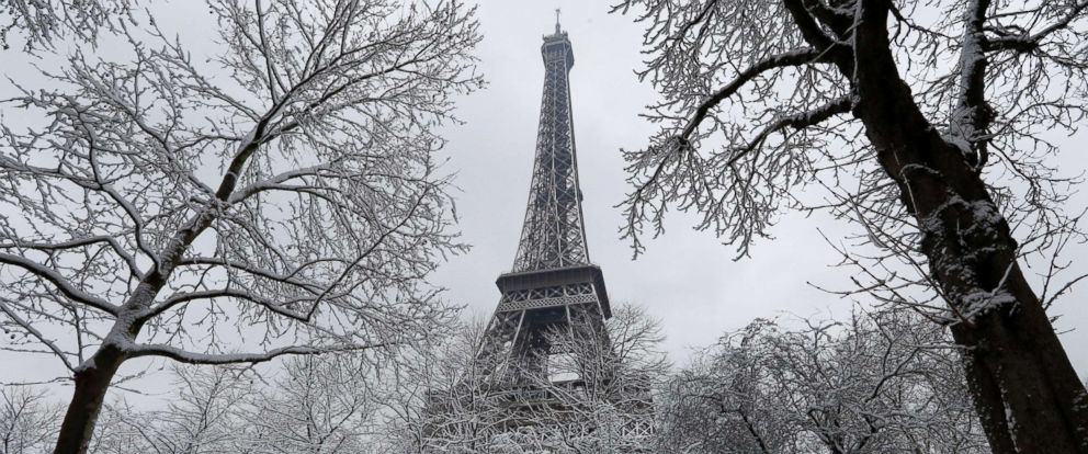 PHOTO: Snow-covered trees are seen near the Eiffel Tower in Paris, as winter weather with snow and freezing temperatures arrive in France, Feb. 7, 2018.