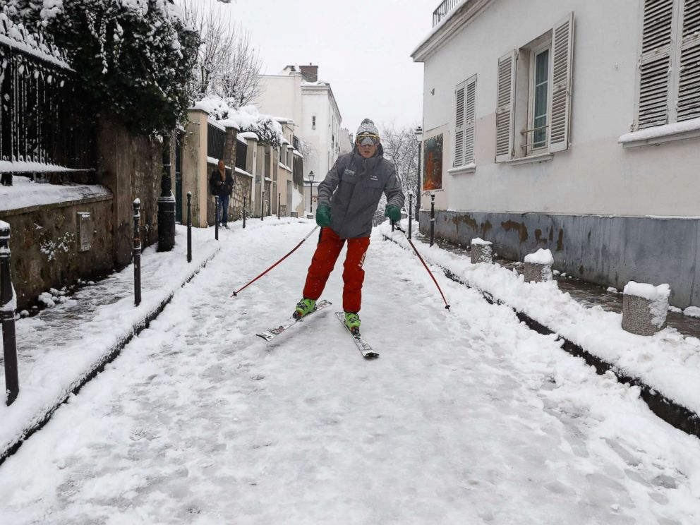 PHOTO: A man skis on a snow covered street of Montmartre, Feb. 7, 2018, following heavy snowfall in Paris.