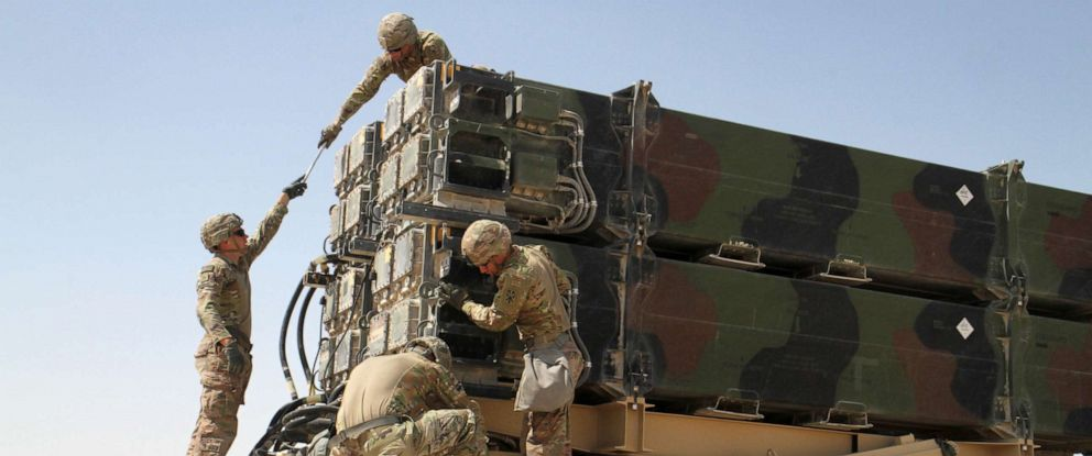 PHOTO: Soldiers from Battery C, 43rd Air Defense Artillery Regiment work together to prepare a Patriot missile launcher for reloading, March 7, 2019.