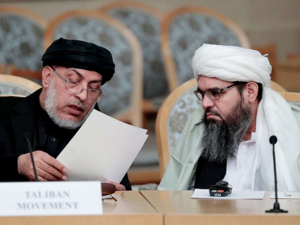 PHOTO: Unidentified representatives of the Afghan Taliban movement speak prior to the start of the second Moscow round of Afghanistan peace settlement talks on Nov. 9, 2018.