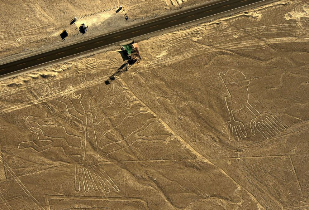 PHOTO: An aerial view of geoglyphs representing a guarango tree (L) and hands are pictured in the Nazca desert, in southern Peru in this Dec. 11, 2014 file photo.