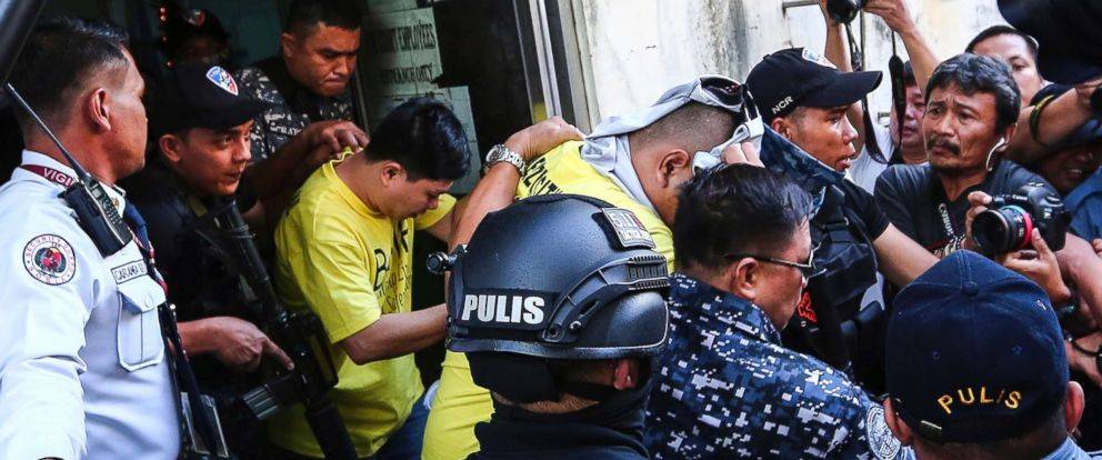 PHOTO: Two of three police officers are escorted out of the courtroom after being found guilty and sentenced up to 40 years without parole for the killing of a student, Nov. 29, 2018, in Caloocan city, Philippines.