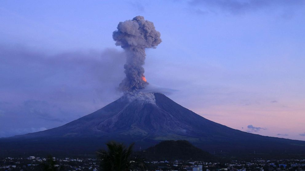 This photo taken from a drone shows a column of ash shooting up from the Mayon volcano as it continues to erupt, seen from the city of Legazpi in Albay province, south of Manila, Jan. 24, 2018.