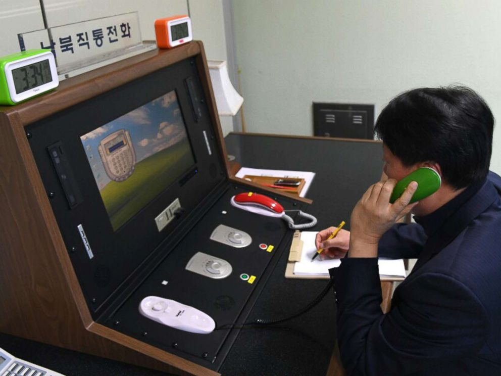 PHOTO: A South Korean government official communicates with a North Korean officer during a phone call on the dedicated communications hotline at the border village of Panmunjom in Paju, South Korea, Jan. 3, 2018.