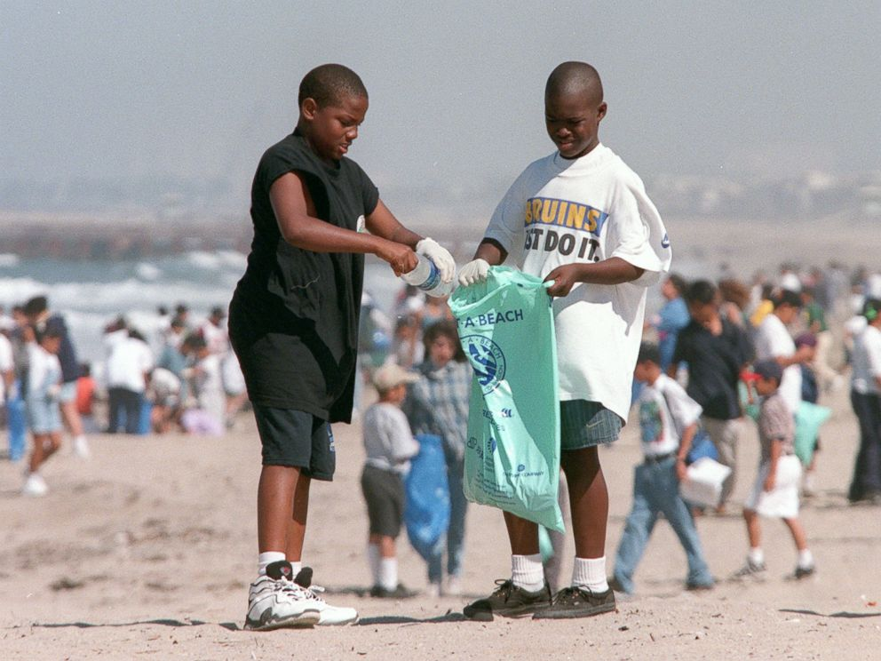 PHOTO: In this file photo, Terrell McNeal, ll, and Tareall Atkins, 10, from Westminister Elementary School in Venice, Calif., clean up plastic bottles on the beach at Dockweiler State beach, April 22, 1997.