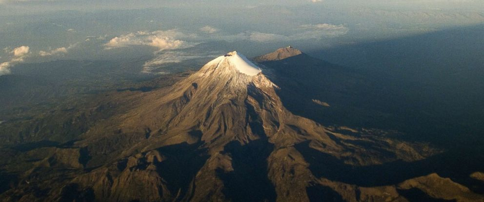 PHOTO: Aerial view of the Citlaltepetl volcano or Pico de Orizaba, the highest mountain in Mexico with 5,636 meters in Veracruz State, Mexico, June 1, 2014.