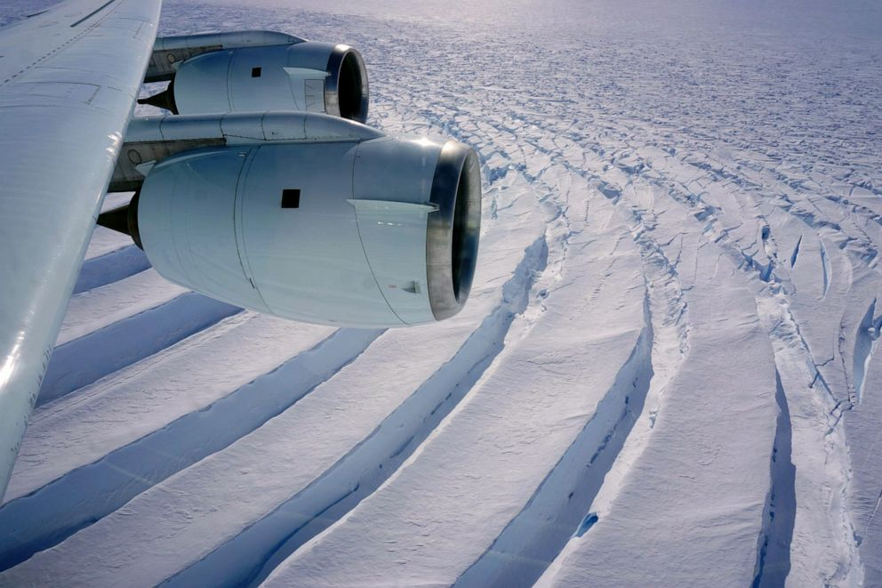 PHOTO: Enormous curved crevasses are seen near the shear margin at Pine Island Glacier in Antarctica.