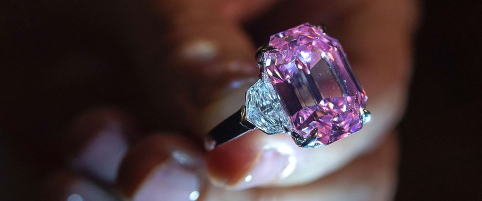 PHOTO: A Christies employee displays an 18.96-carat fancy vivid pink diamond during a preview at Christies in Geneva, Switzerland, Nov. 8, 2018.